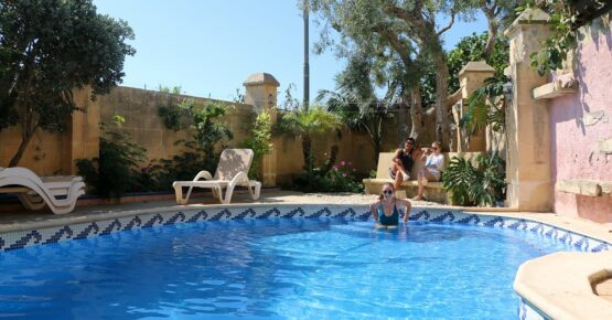 in the garden and pool area at il-Wileg bed and breakfast in Gozo